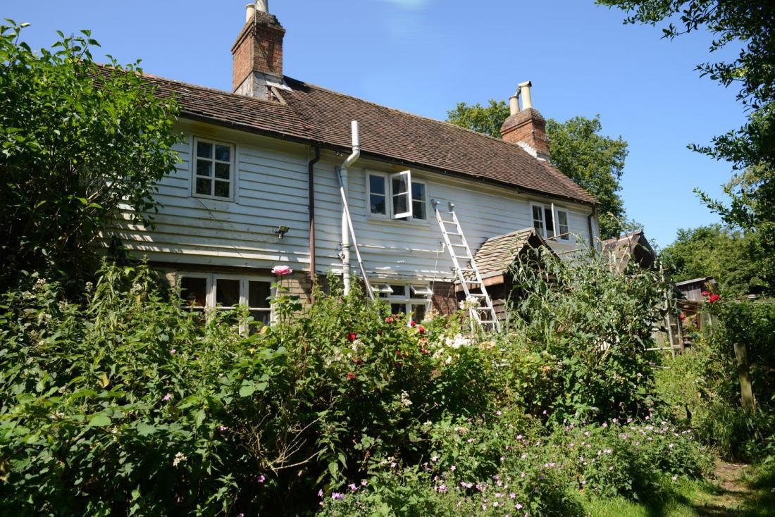The cottage exterior, a great tumble-down backdrop for shoots.