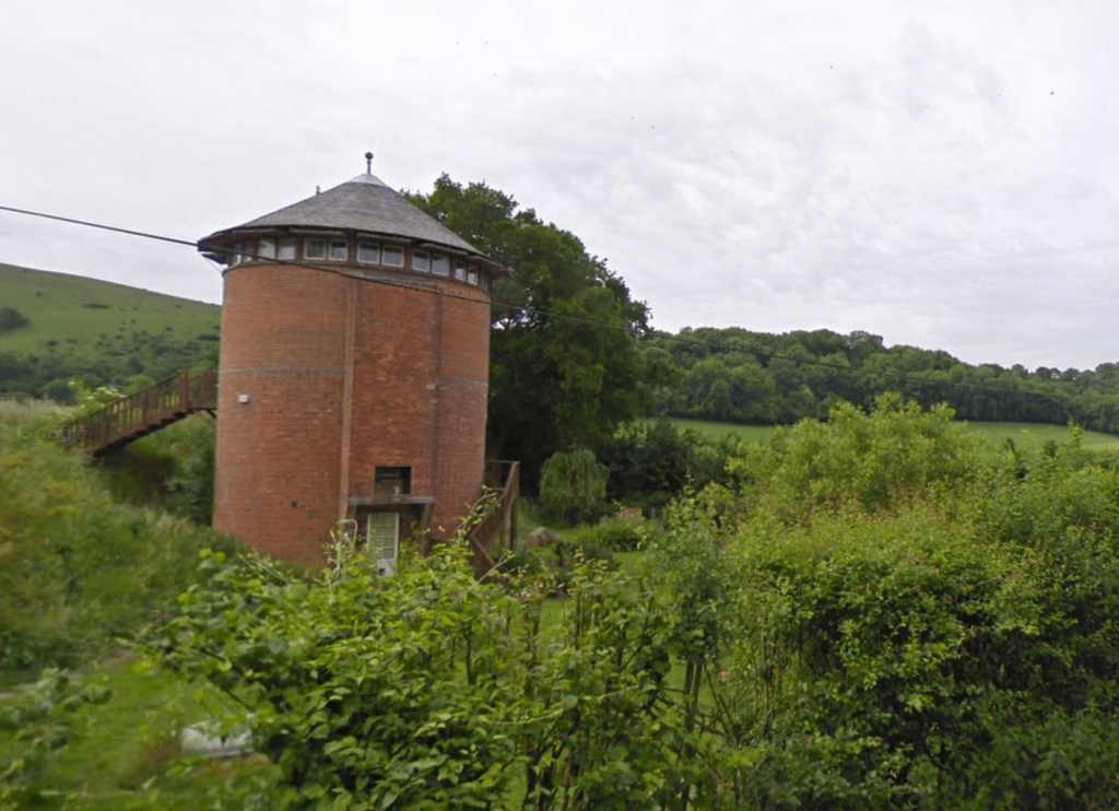 Nutcombe Tower in its former incarnation - pic provided by the property's owners.