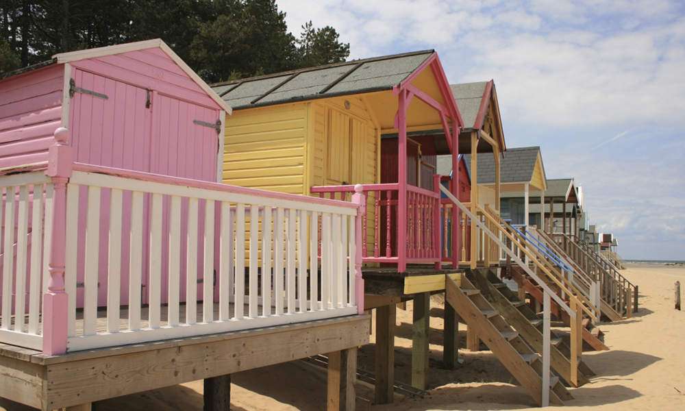 Colourful beach huts at film and shoot location Holkham Estate