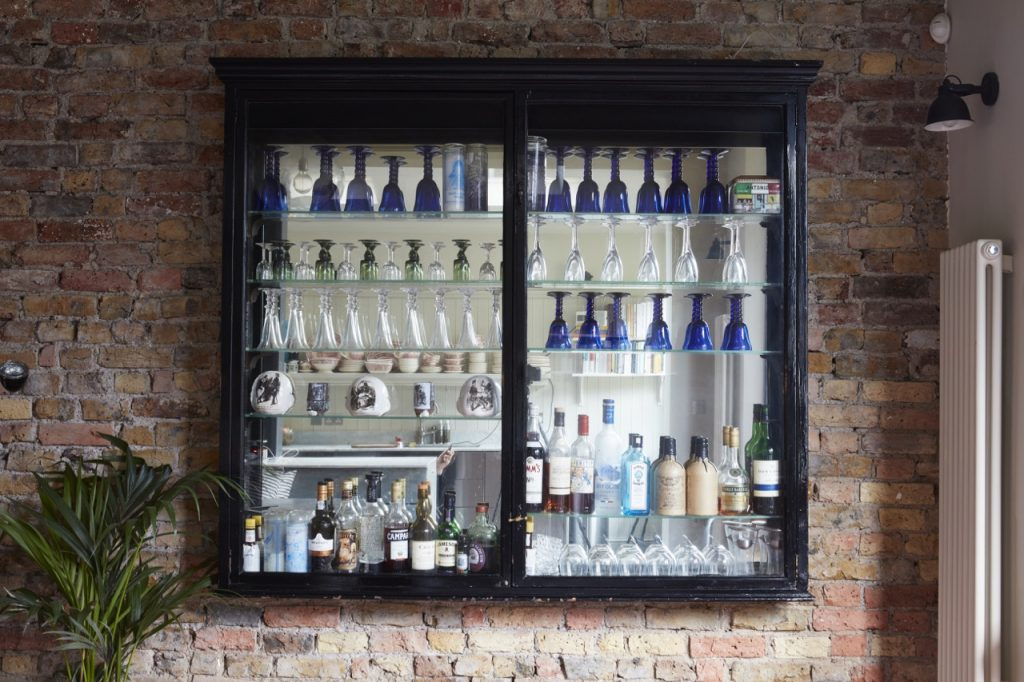 Victorian style cabinet on the exposed-brick wall in the kitchen at Victorian Briars