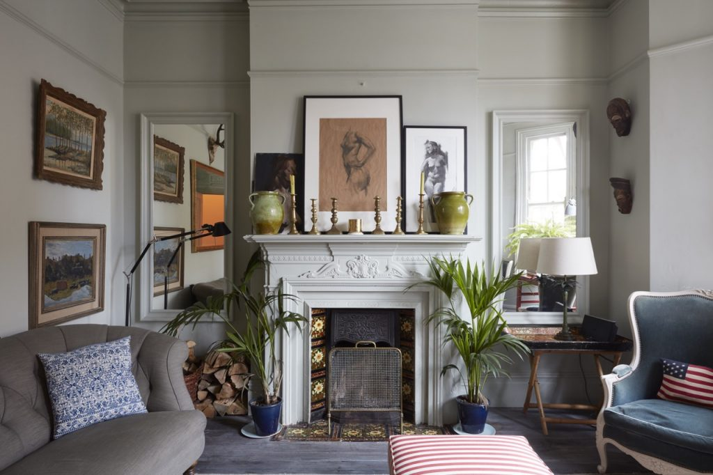 The living room at Victorian Briars, peppered with art, vintage wares and newer, stylish pieces that compliment the original period features