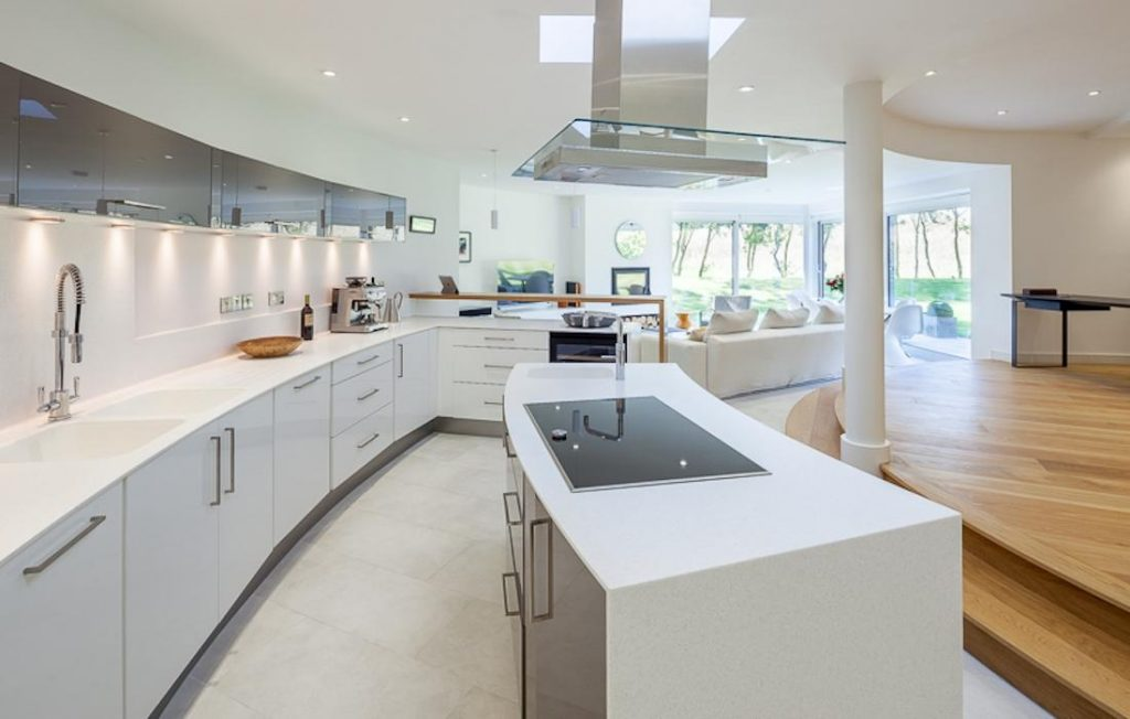 The kitchen at the location includes an extensive kitchen island with a central hob.