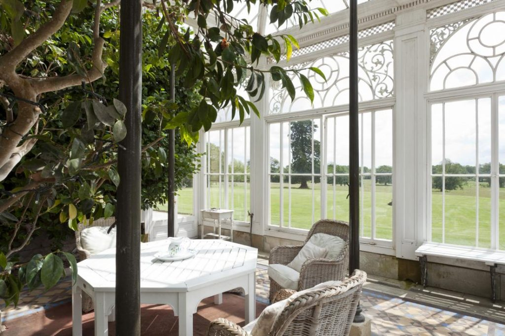 The dining space is a magnificent mint, complete with delicate wall murals.