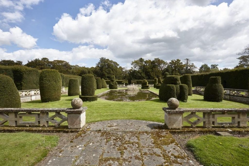 Topiary of the Pops. Apethorpe exhibits grandeur both indoors and out.