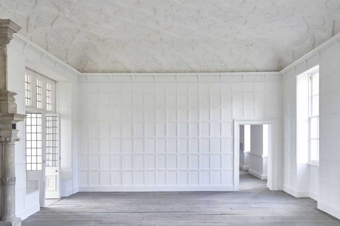 One of the state rooms at Apethorpe Palace. White panels with well preserved plasterwork adorning the ceiling.