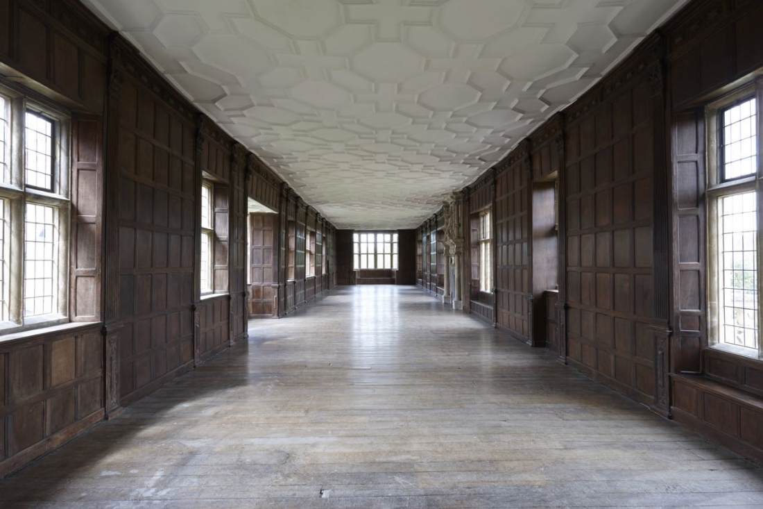 Interior view of Apethorpe's Long Gallery with with masculine wood panelling. The trees used for the floors were personally selected by James I.